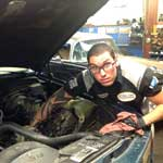 Senior technician, Kelly Schultz, diagnosing cooling system